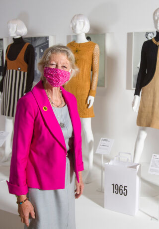 Photo of a lady stood in our Mary Quant exhibition.