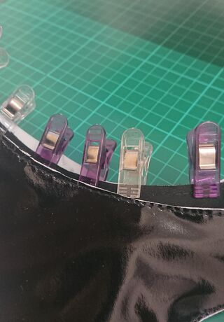 PVC fabric clipped with clothes pegs as it's being worked on.
