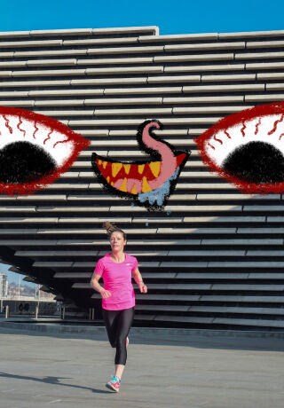Photo of V&A Dundee with big eyes and a hungry mouth illustrated over the building as if it's come alive and is about to eat the person running away from it.