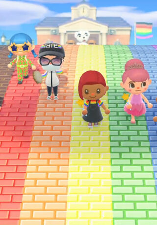 An image of several characters from Animal Crossing walking over a bridge which is decorated with the pride flag colours.