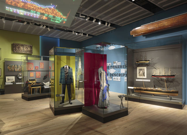 Photograph of our Scottish Design Galleries with a selection of objects from clothes to ship models to furnature and decrative items