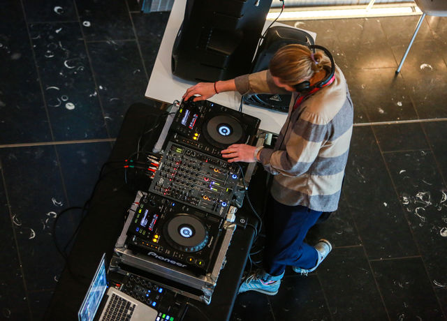 Young person mixing music at record decks