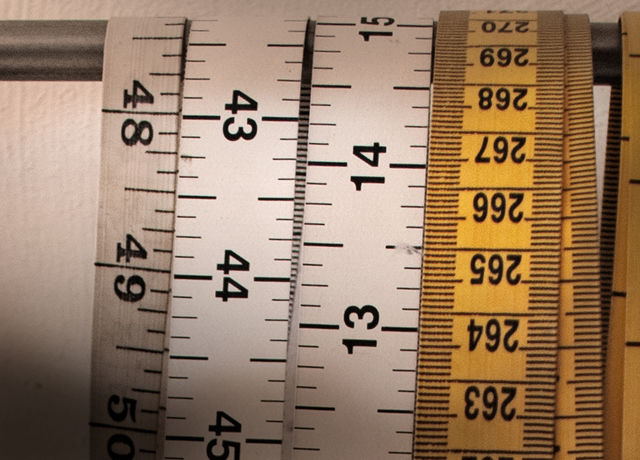Close-up photo of measuring tapes.