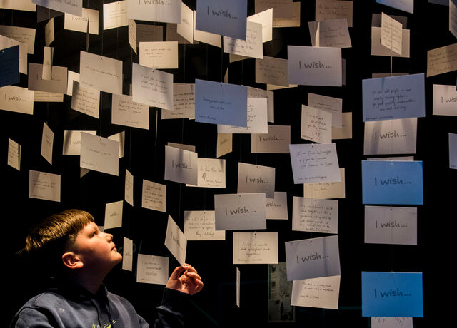 A boy looks at the cloud of dreams, part of the What if...? Scotland exhibition