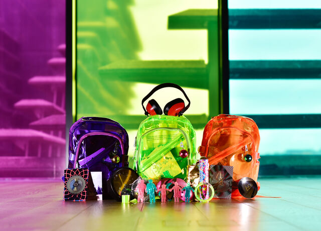 Three brightly coloured backpacks containing multi-sensory and accessibility friendly items