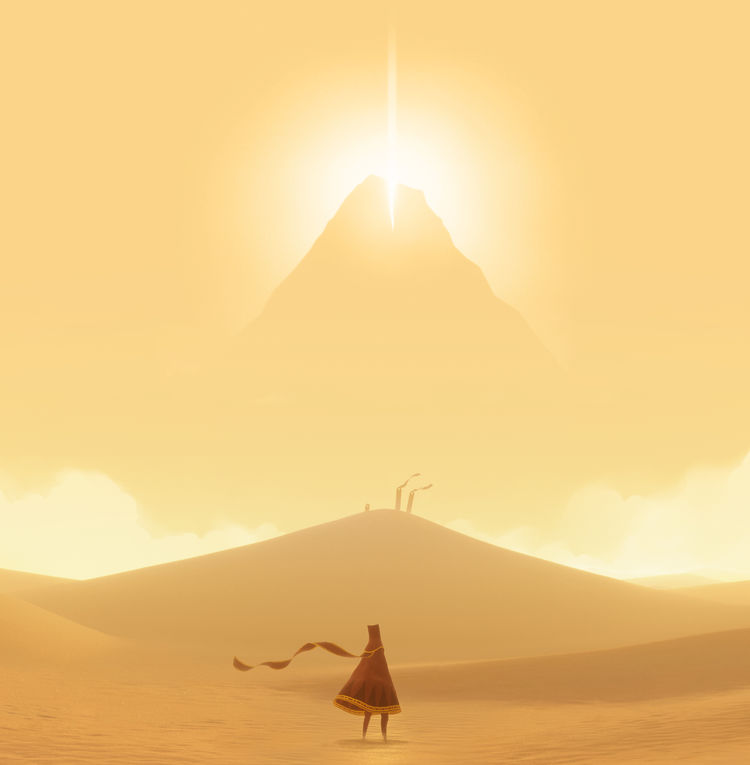 Screenshot from Journey, a scene with a figure in the fore ground and a mountain in the distance