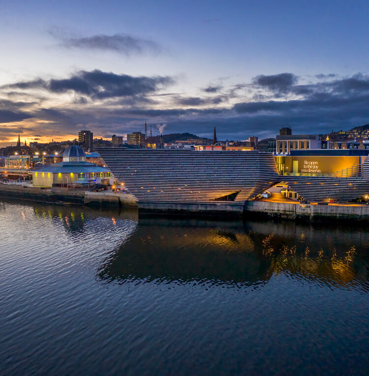 A photo of V&A Dundee taken over the river by a drone in the early everning - Focus Frame Photography