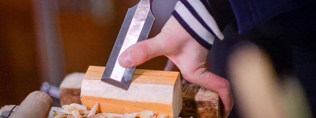 Close up on hand doing woodwork
