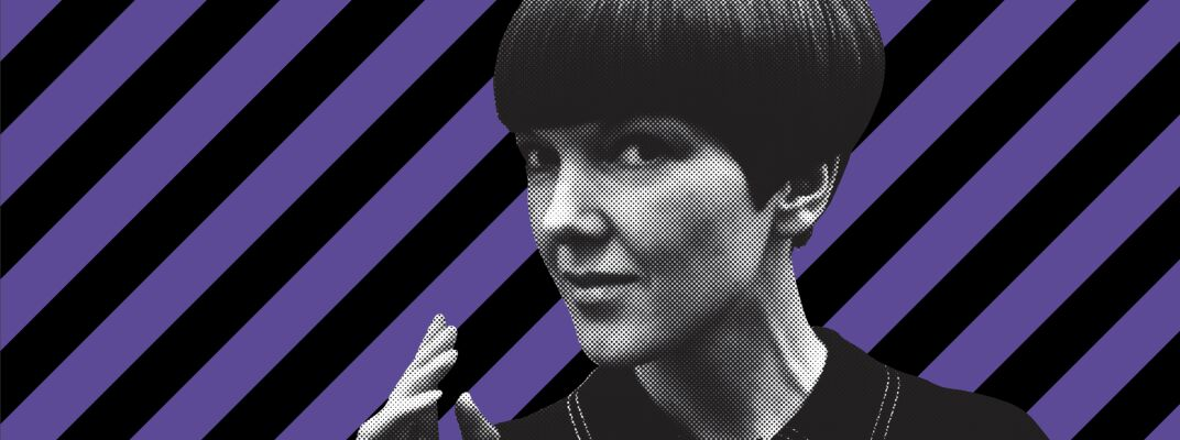 Mary Quant's head in black and white against purple and black stripes.