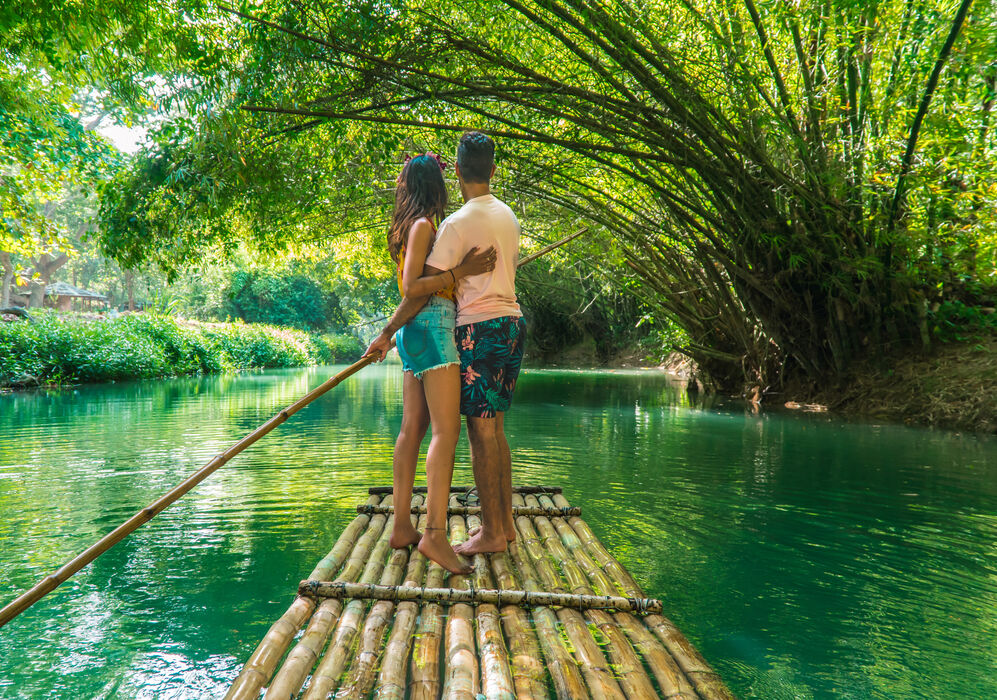 Couple on raft along the Martha Brae River