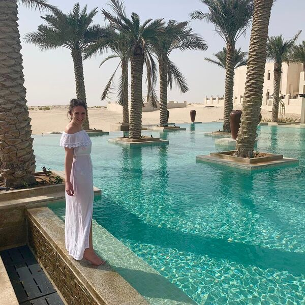 By the pool at Jumeirah Al Wathba Desert Resort & Spa