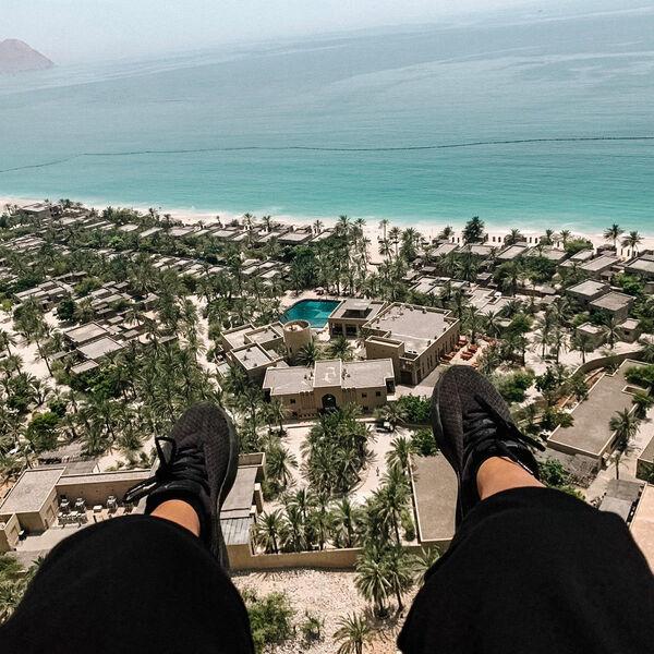 Paragliding into Six Senses Zighy Bay