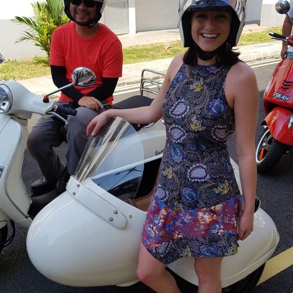 Exploring by vintage Vespa sidecar