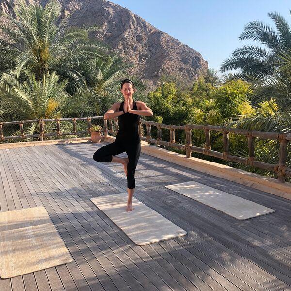 Alice enjoying sunrise yoga