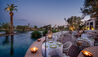 Dining Terrace And Pool In The Evening