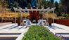 Matakauri Lodge : Outdoor Lounge Area And Fireplace