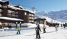 Le Val Thorens : Skiers Skiing Past Le Val Thorens