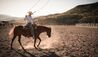 The Lodge at Blue Sky : cowboy on horse with lassoo